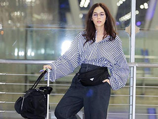 泰星Chompoo携带11箱行李参加巴黎时装秀,双胞胎儿子同行