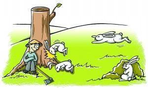 一个人在砍树,旁边有蜜蜂和小兔子的图树桩和蝴蝶310图片